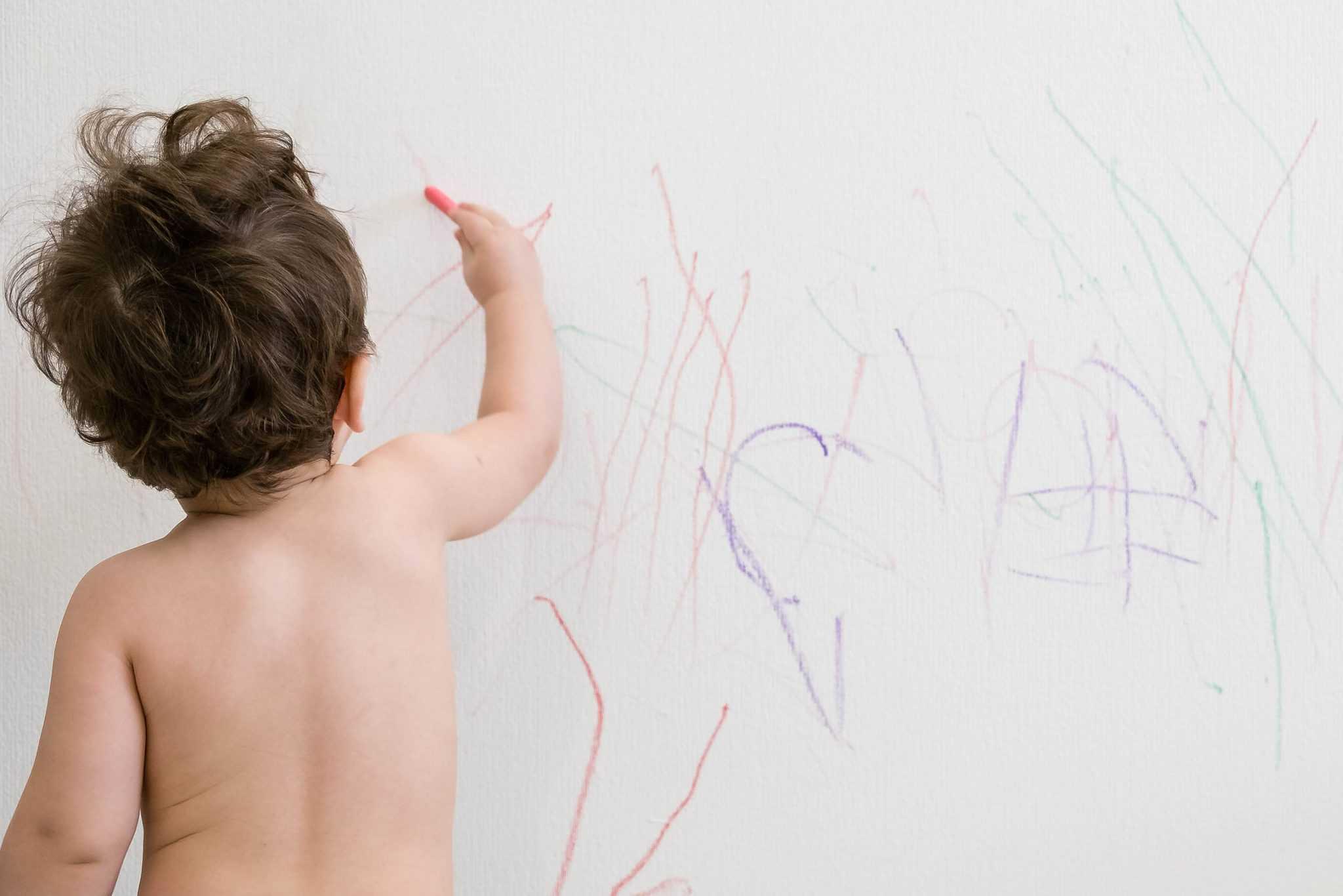 kids scribbling on wall